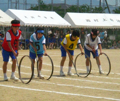 push the wheel with stick race Japan