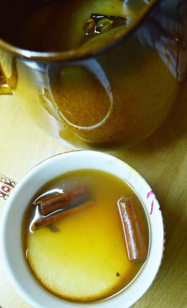 serving hot apple cider with mulled wine spice