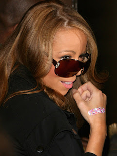 Mariah Carey wearing a cute Hello Kitty band aid