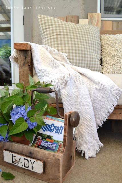 pallet wood sofa with a drill handled toolbox for an outdoor porch or patio | funkyjunkinteriors.net