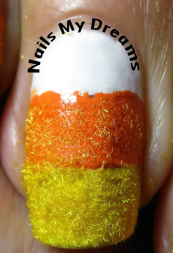 candy corn nail art textured with flocking powder macro shot