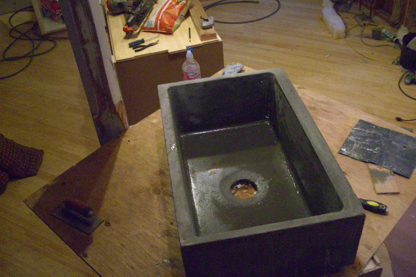 concrete countertops: large farm sink, just out of the mold