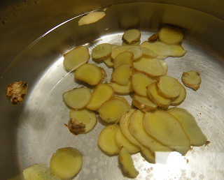 Saucepan with Ginger Slices and Water