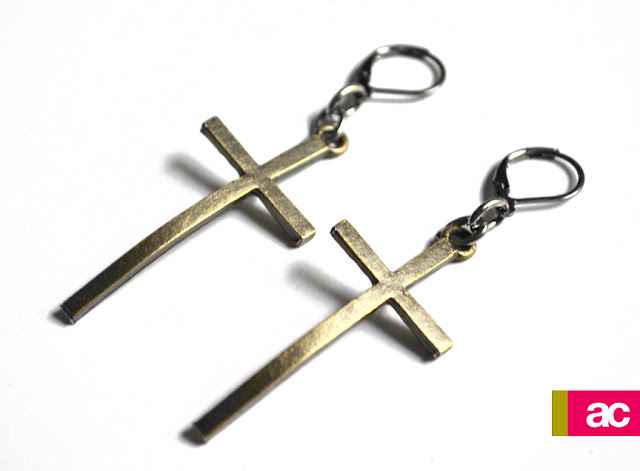 Oversized skinny curved cross earrings