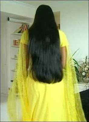Homely girl from Madurai with loose silky long hair.