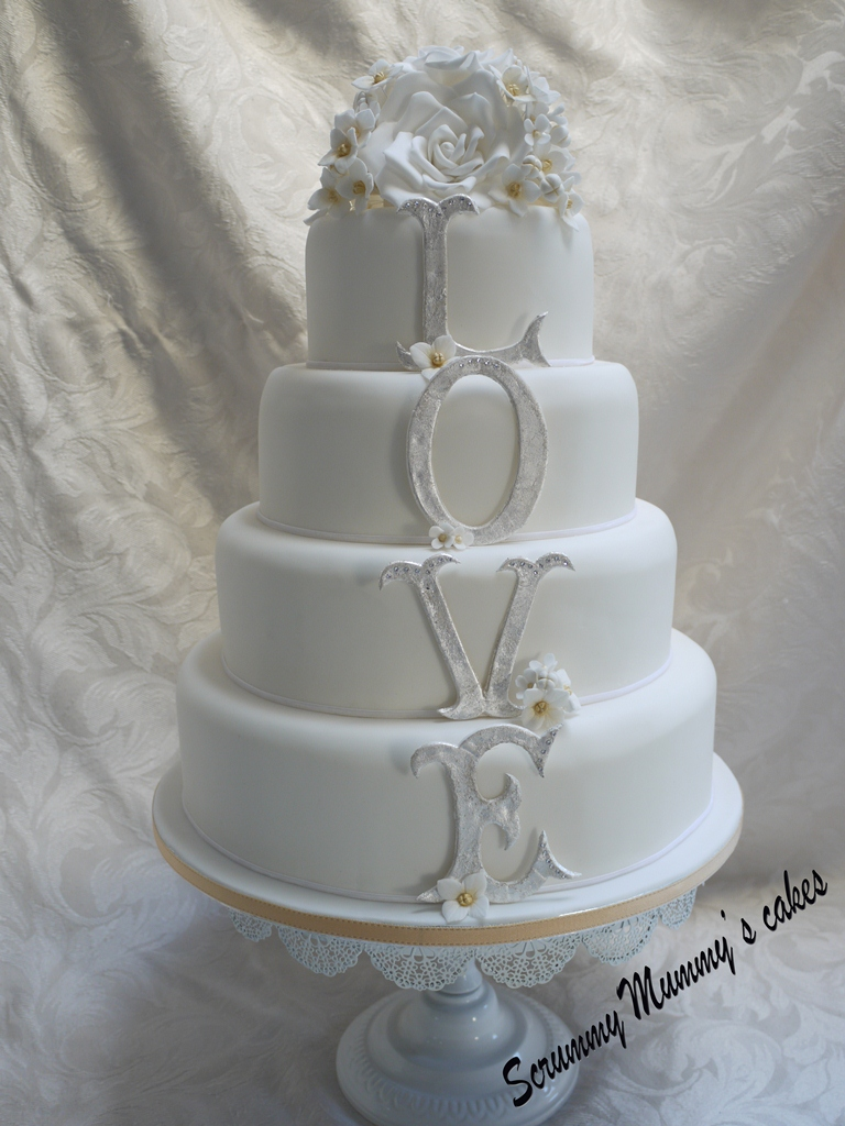 Scrummy mummy 39 s cakes 4 tier monogram 39 love 39 wedding cake for Wedding cake layer