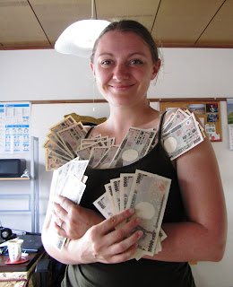 Girl holding lots of money
