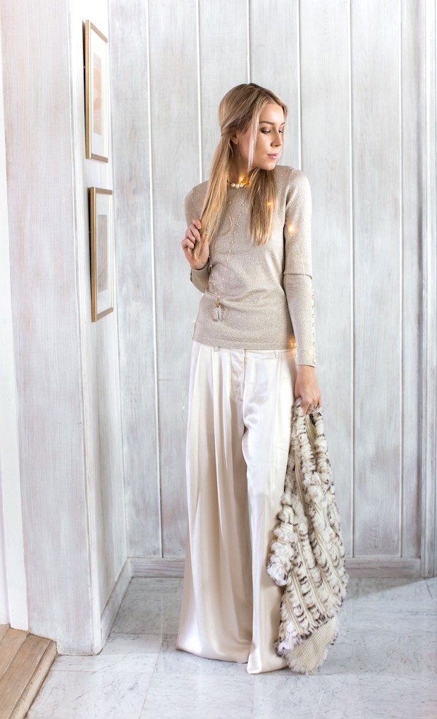 winter white wide leg trousers glitter gold sweater fur cape holiday style holiday party outfit The Supper Model