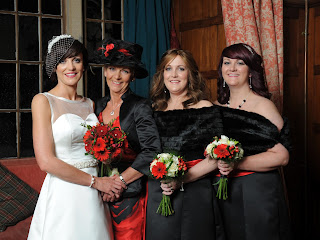 Bride in white wedding dress with mum and sisters on her wedding day in scotland