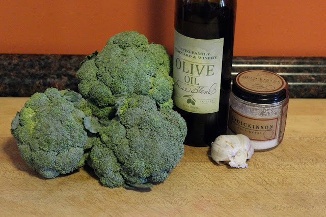 The ingredients needed to make the roasted broccoli.  Broccoli, garlic, olive oil, salt, and pepper.