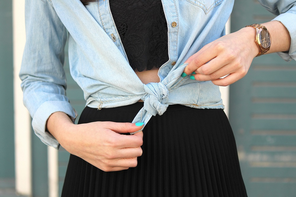 peexo fashion blogger wearing pleated midi skirt with lace bralet and denim shirt in spring