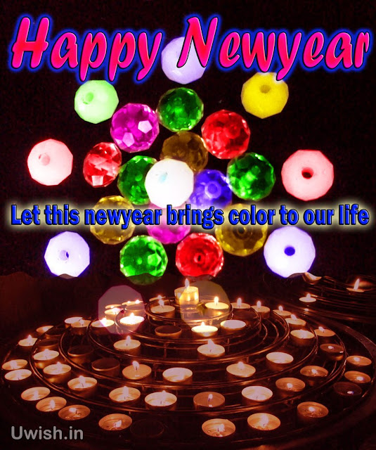 Happy Newyear 2013 wishes and greetings with color stones and pearls along with candles.