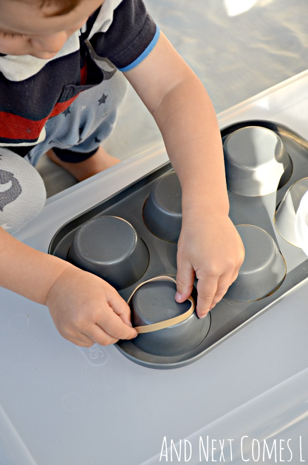 Working on fine motor skills using muffin tins and rubber bands from And Next Comes L