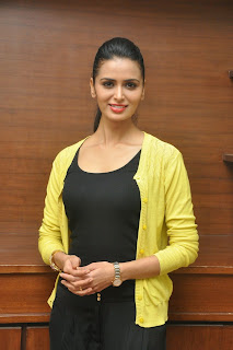 Meenakshi Dixit in Black TIght T Shirt Black Trousers and yellow Coat Stunning Spicy Beauty