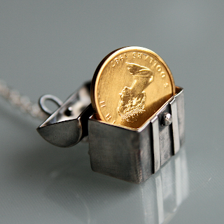 Silver treasure chest pendant necklace with golden coin