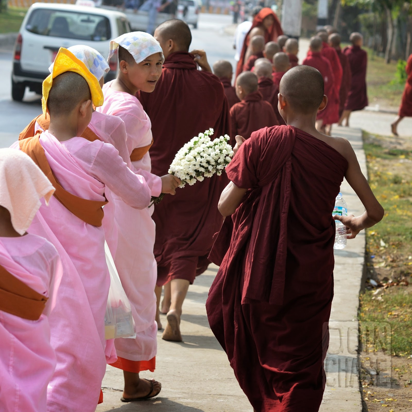 Monks and nuns walking together in Yangon, Myanmar.