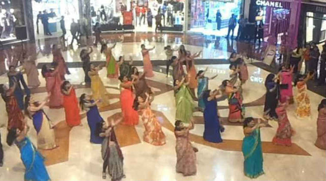 A group of 50 saree-clad women performed a flash mob dance at Select City Walk, a mall in South Delhi.  A video of the performance shows them matching steps and moves to hit Bollywood numbers as the crowd taken by surprise cheers on enthusiastically.