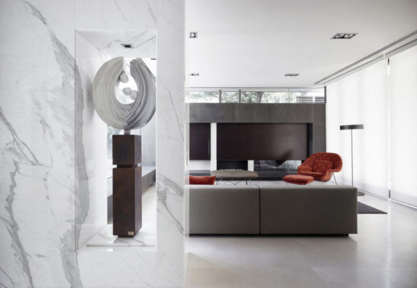Photo of modern living room as seen from the hallway with marble walls