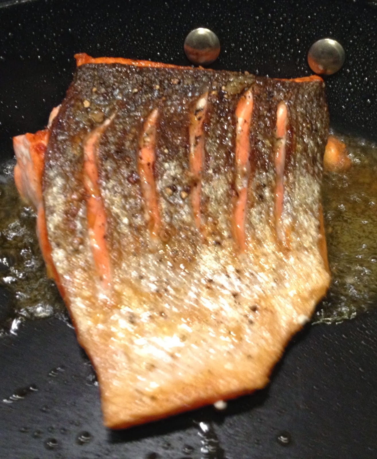 Once Turned To The Flesh Side Of The Fillet, Tilt Pan And Let Olive Oil Cook  The