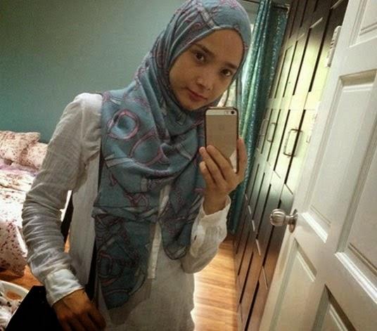 Noor Hafizah Idrus pilot wanita Air Asia yang comel bertudung serta gambar
