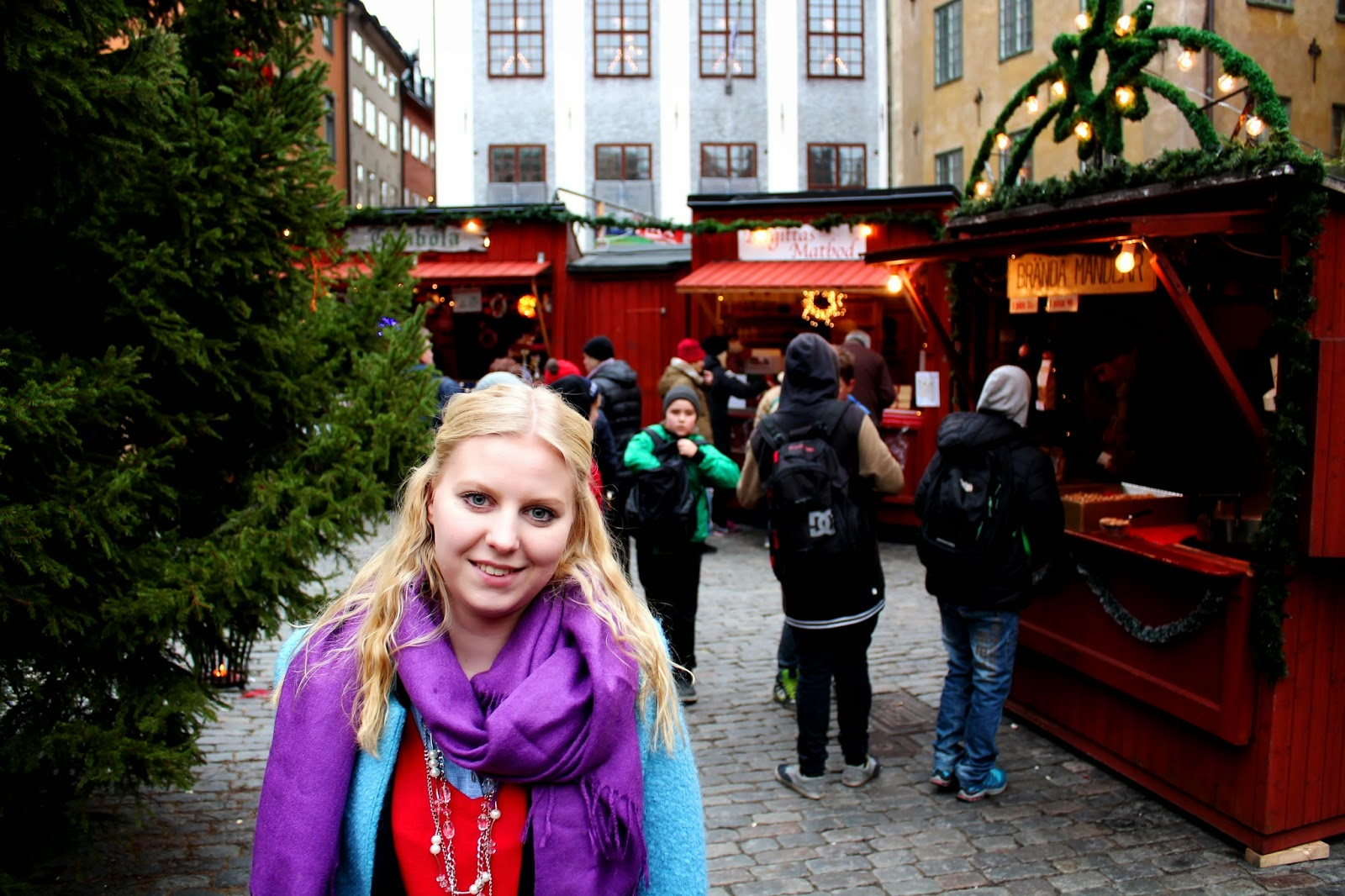 christmas market in Stockholm winter photography with a blond girl
