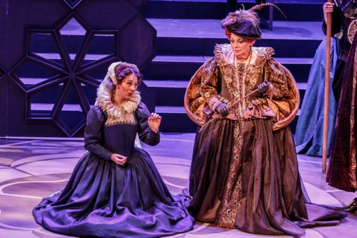 Queen Mary Stuart of Scotts kneels beside Queen Elizabeth I in Donizetti's opera.
