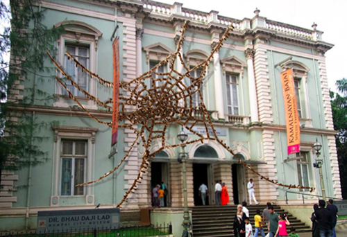 A massive, compelling cobweb besieging the front facade of the Dr. Bhau Daji Lad Museum, Mumbai