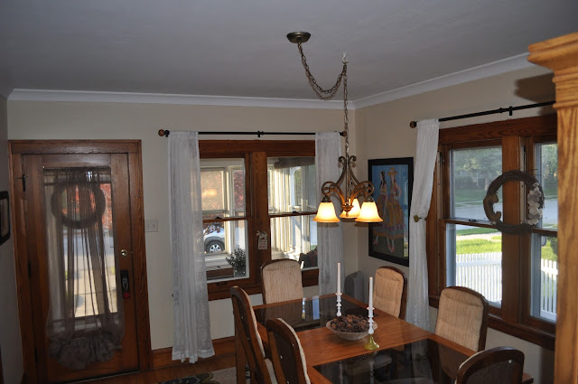 dining room, crown moulding, paint, candles, curtain holdbacks
