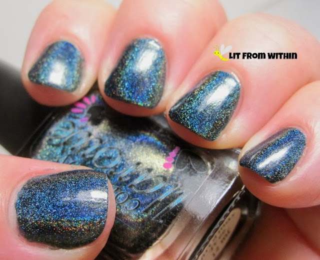 This is such a neat holo - it's emerald green, but with a LOT of blue in it.