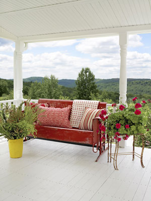 This gorgeous red vintage bench is a stark contrast to the white porch. The view from this patio is amazing!