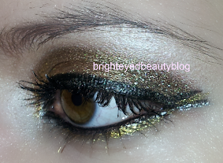 New Year's Eve mixed metals graphic eyeliner eye look, close up of the graphic eyeliner detail