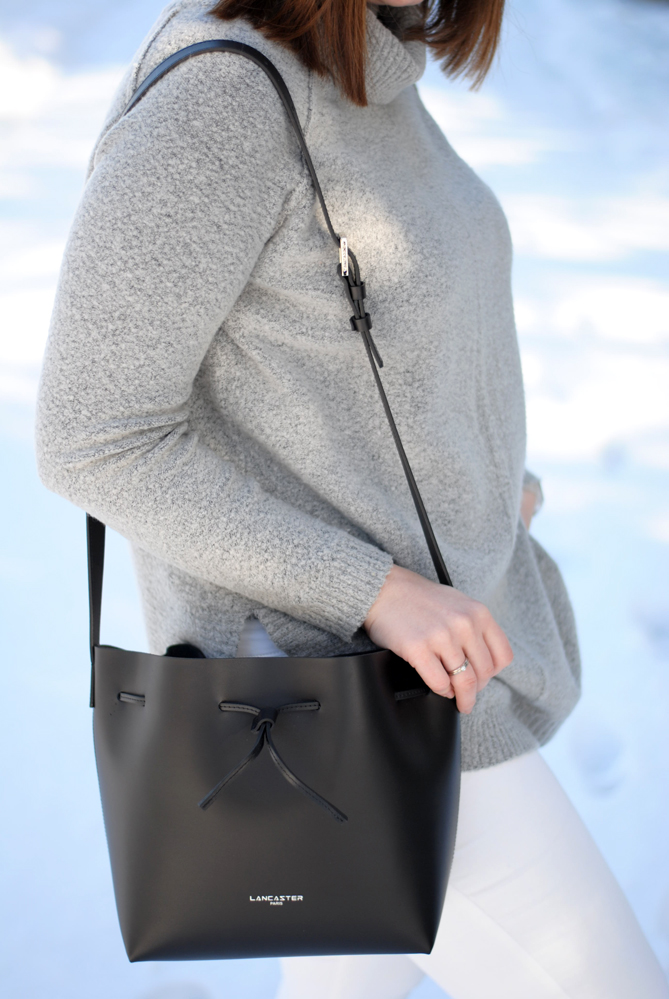 blue white snow winter outfit black bucket bag
