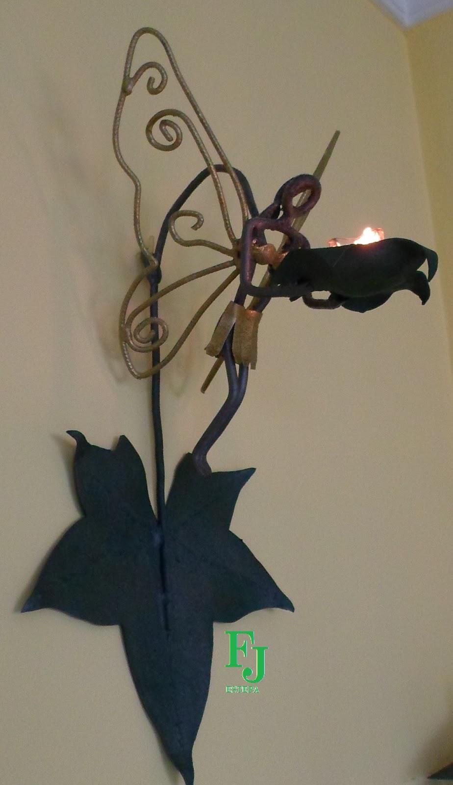 Artesan a en hierro estepa figuras y s mbolos - Portavelas de hierro ...