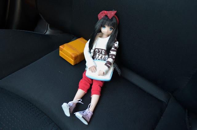 yuzuha doll sitting in the car