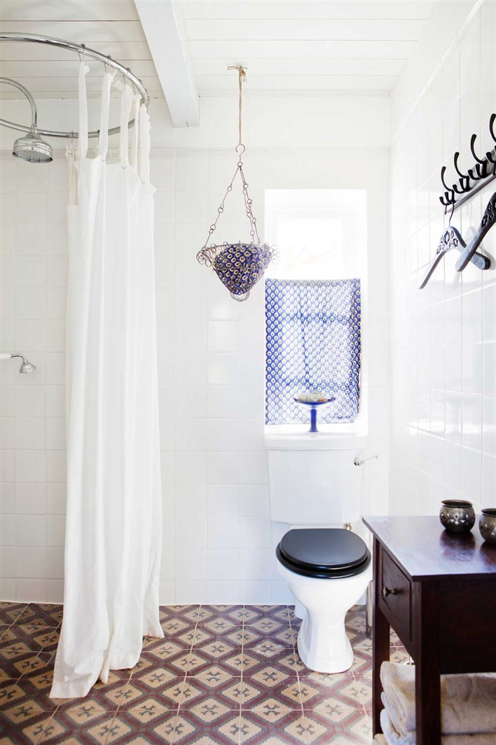 Bathroom with cement Moroccan tile floor, the shower is not enclosed and the floor is continuous throughout the bathroom