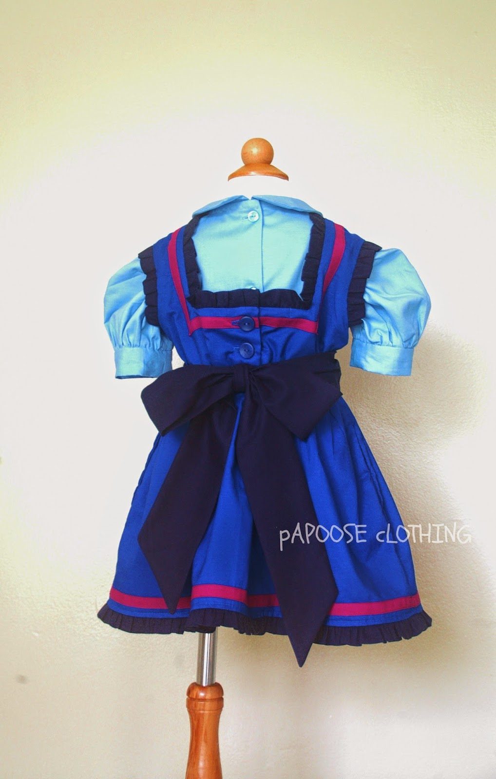 http://www.papooseclothing.com/store/p46/Ice_Princess_Blue_Pinafore_Dress_and_Blouse.html
