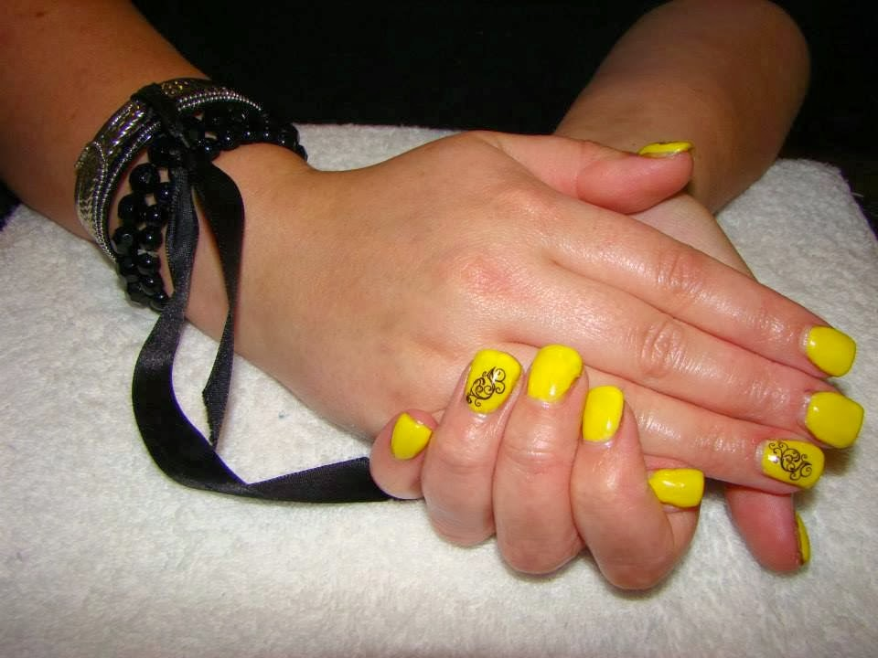 Yellow With Black Nail Tattoo