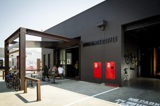 Kaper design restaurant hospitality design inspiration code black coffee for Industrial warehouse exterior design