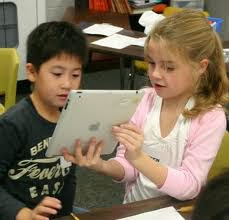 Students using an iPad