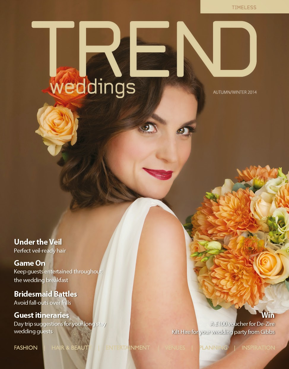 Trend Wedding magazine front cover with model smiling holding a autumnal style bouquet