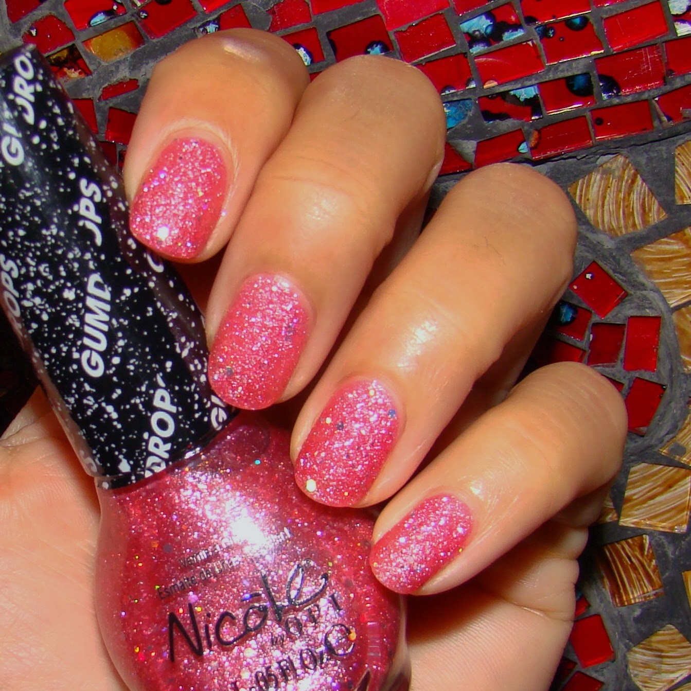 Nicole by OPI Candy is dandy texture polish