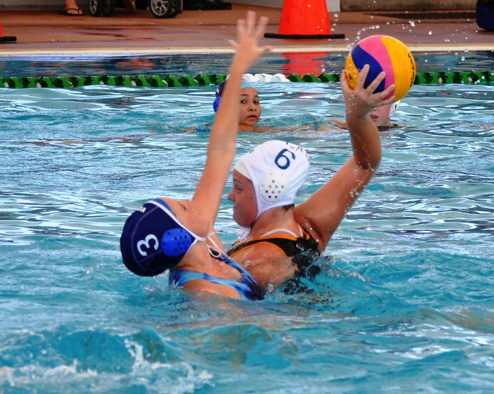Madi Smith ( No 3) in action at the QLD Waterpolo Championships