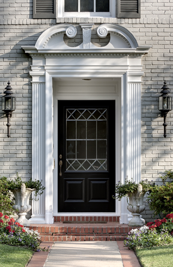 A beautiful pair of sconces flank this grand front door entrance the pup is a nice accessory not sure if I love the urns to the left House Beautiful & You had me at the front door....... - The Enchanted Home