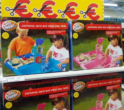 Blue sand pit with boy and girl, pink with only girl