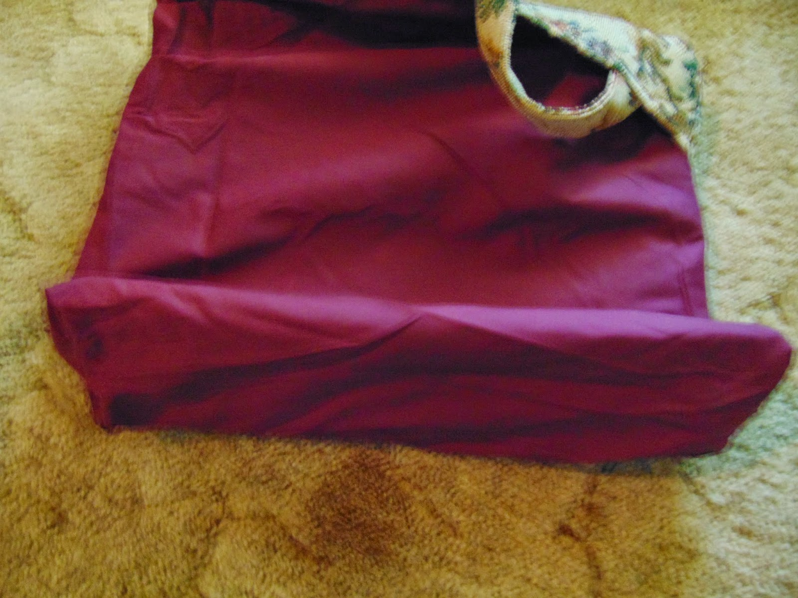 burgundy lining fabric shows inside of tote bag