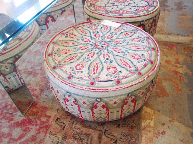 Two round drum shaped Moroccan style poufs covered in vintage fabrics