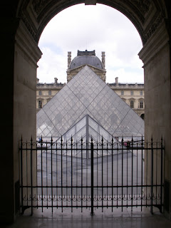 two of the glass pyramids at the louvre in paris