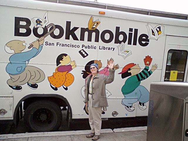 Cynthia Parkhill waves from in front of San Francisco Public Library Bookmobile