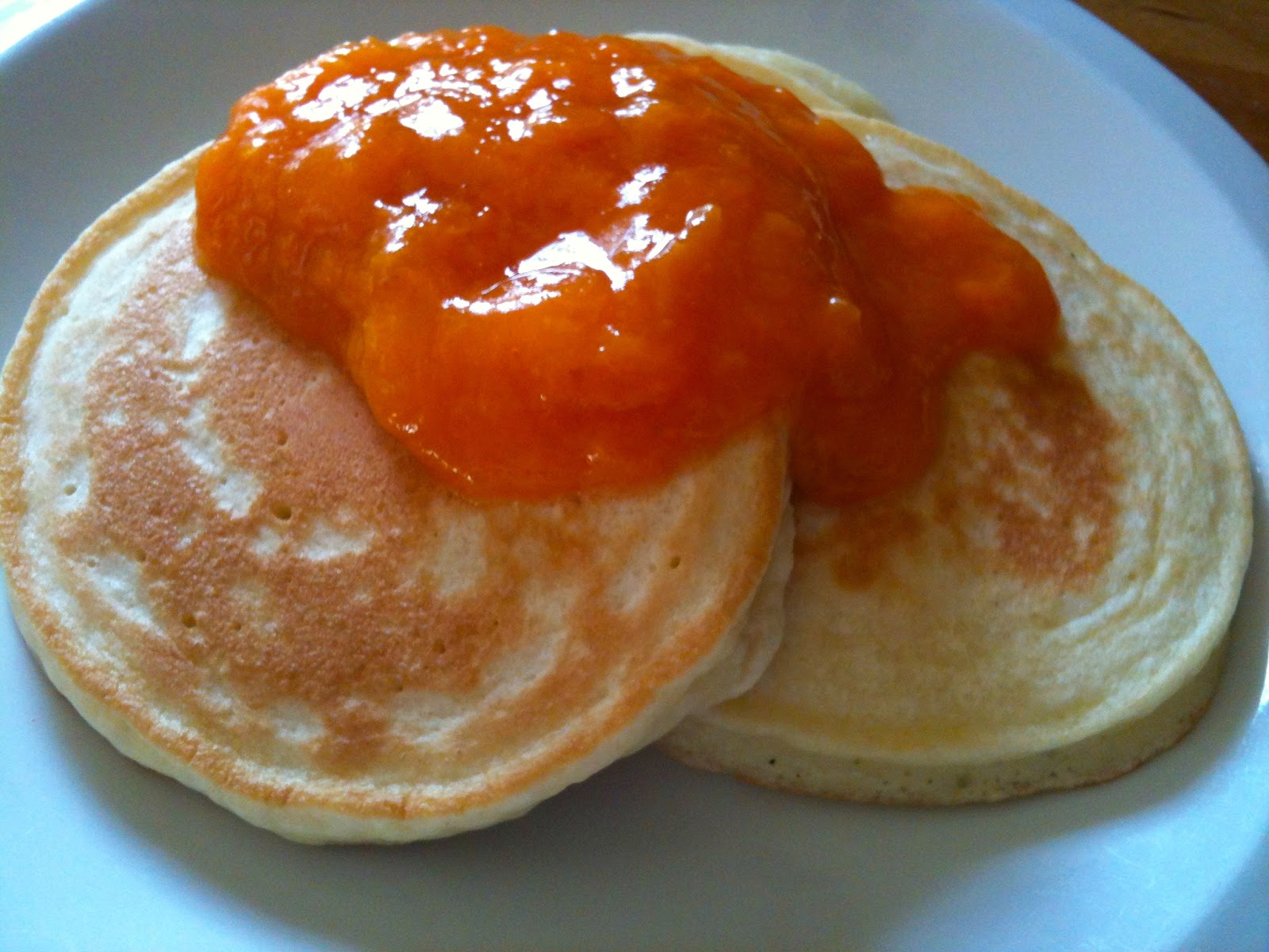 Pancakes topped with apricot sauce. All I did was mash up a cup of ...