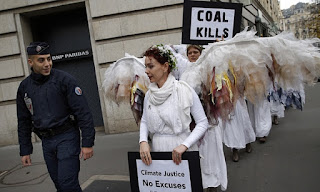 Climate Change Demonstrators dressed as Angels with Coal Kills Signs